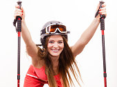 Fit girl with ski poles.