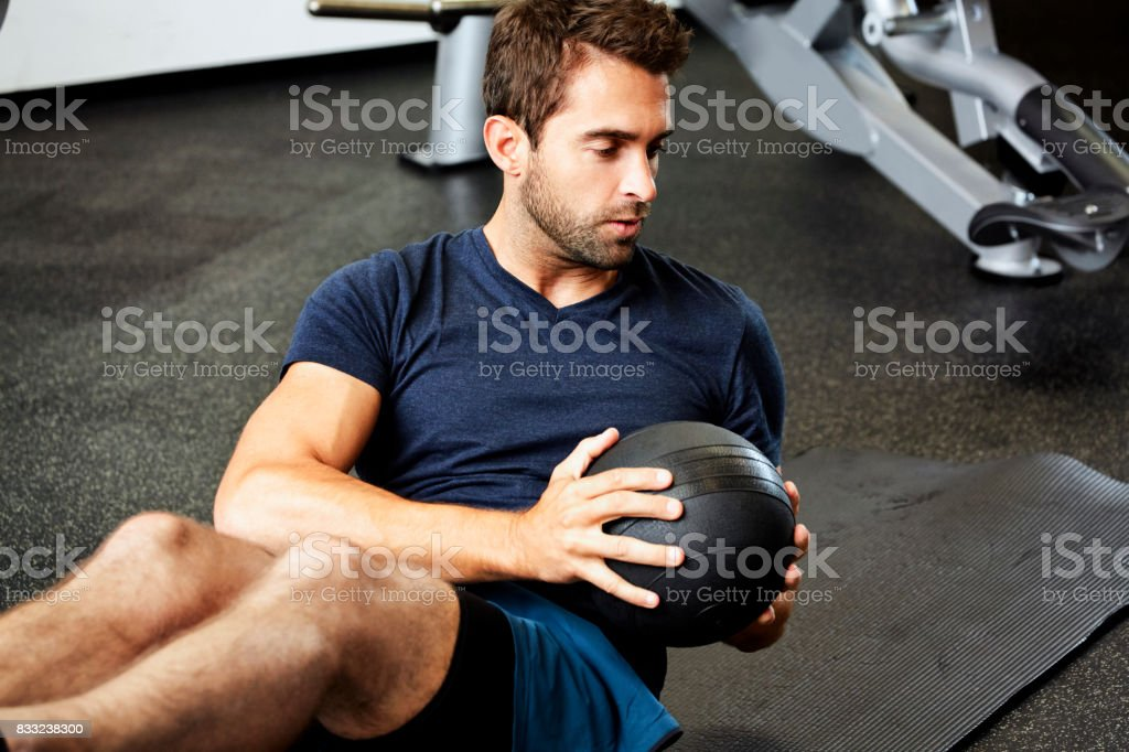 Fit guy in gym stock photo