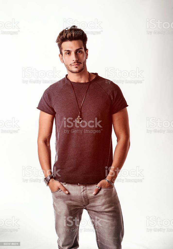 Fit handsome young man standing confident in casual clothes stock photo