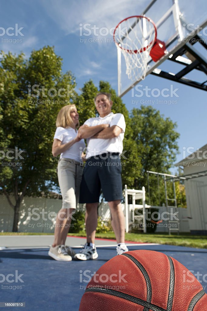 Fit, Healthy and Happy Senior Couple on Basketball Court (Copyspace) royalty-free stock photo