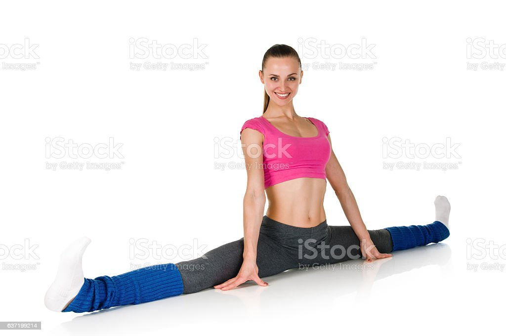 Fit healthy woman stretching stock photo