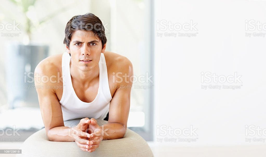 Fit male doing pilates exercises at the gym royalty-free stock photo