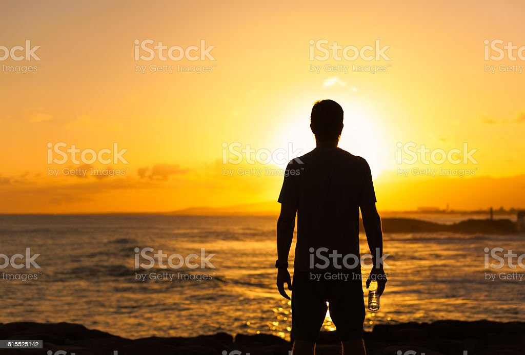 Fit male looking out into the horizon stock photo