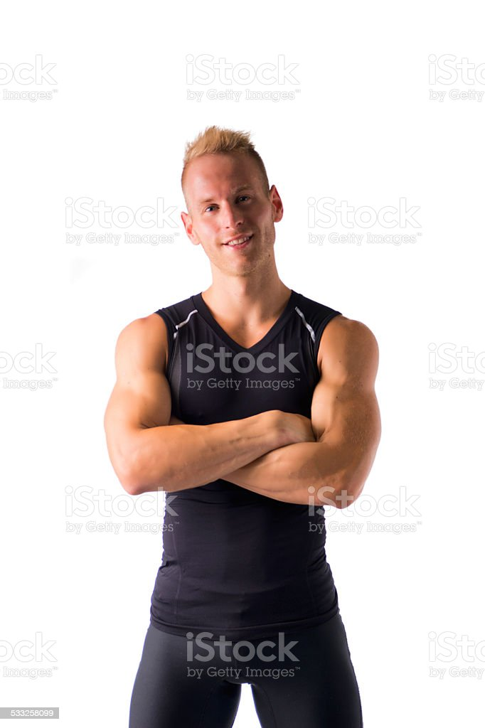 Fit male model smiling with a lot of confidence, arms stock photo