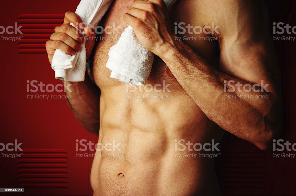Fit man at the front of lockers royalty-free stock photo