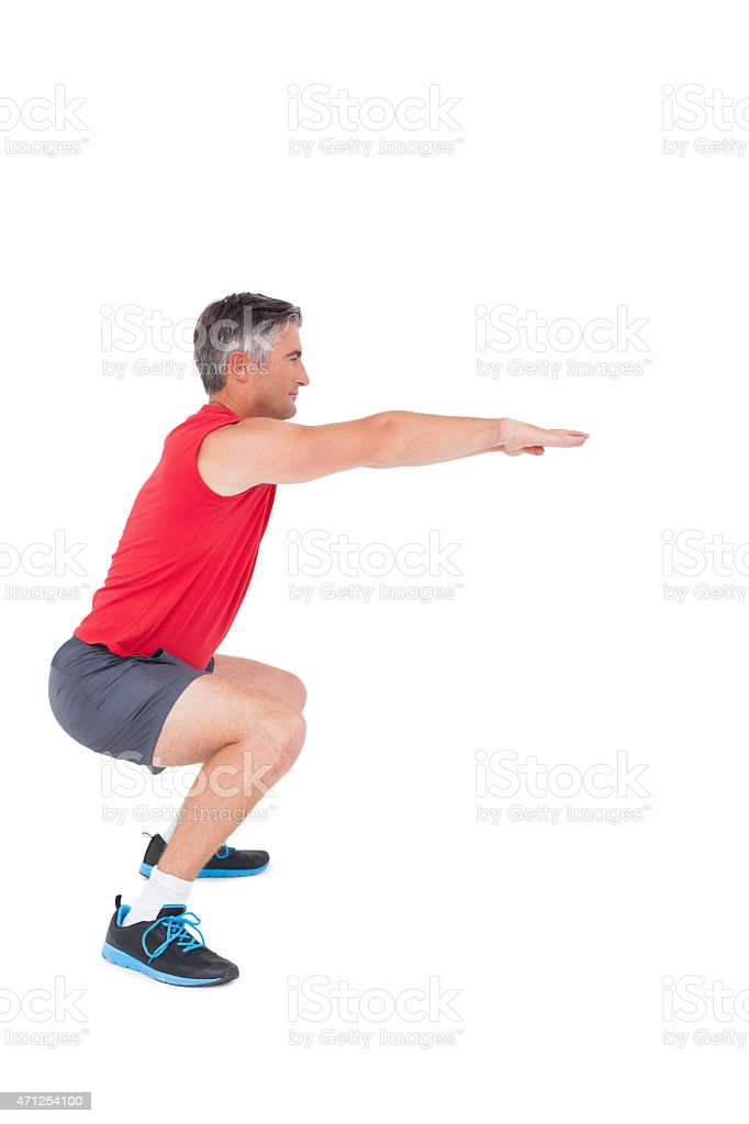 Fit man doing a squat stock photo