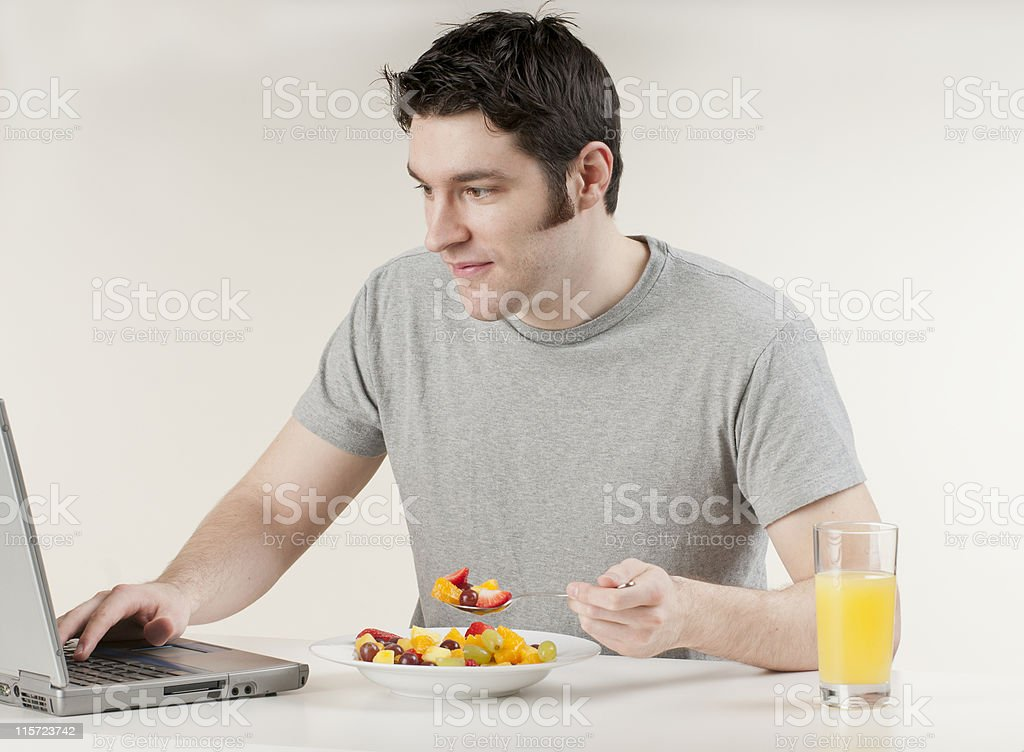 Fit Man Eating a Fruit Salad royalty-free stock photo