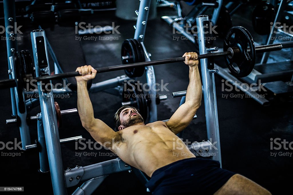 Fit Man Exercising in a Gym stock photo