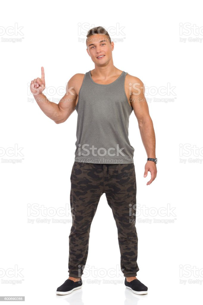 Fit Man In Camo Pants Pointing Up stock photo