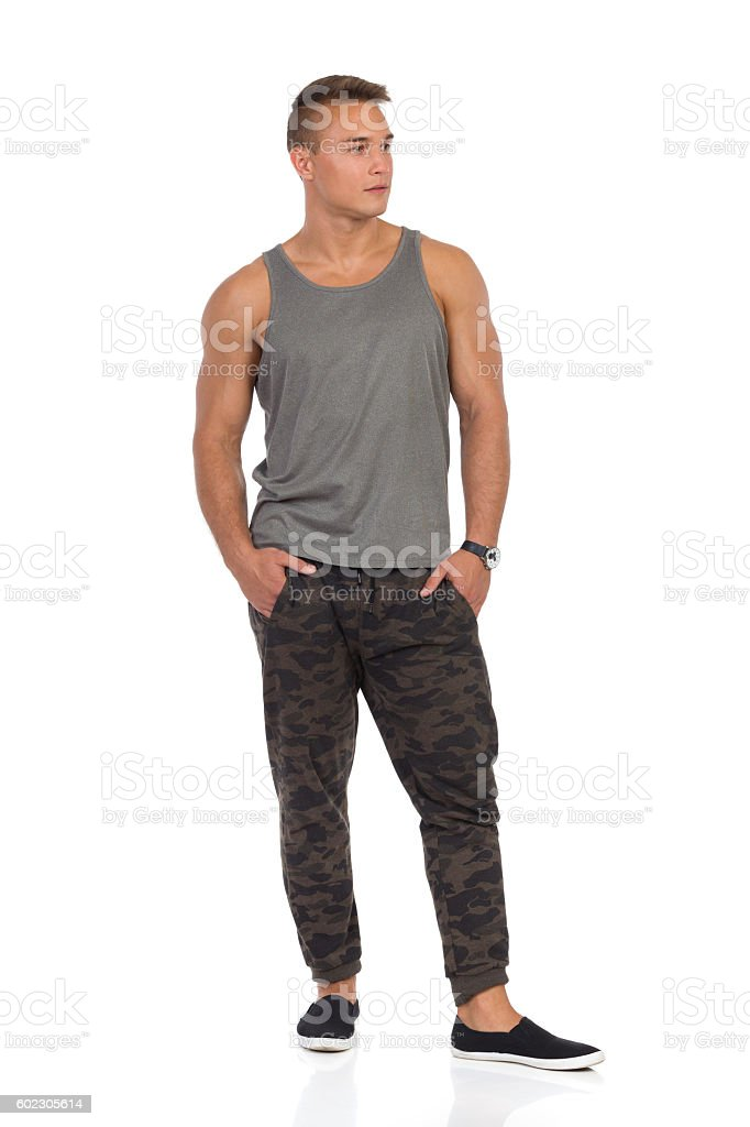 Fit Man In Camo Pants Standing With Hands In Pocket stock photo