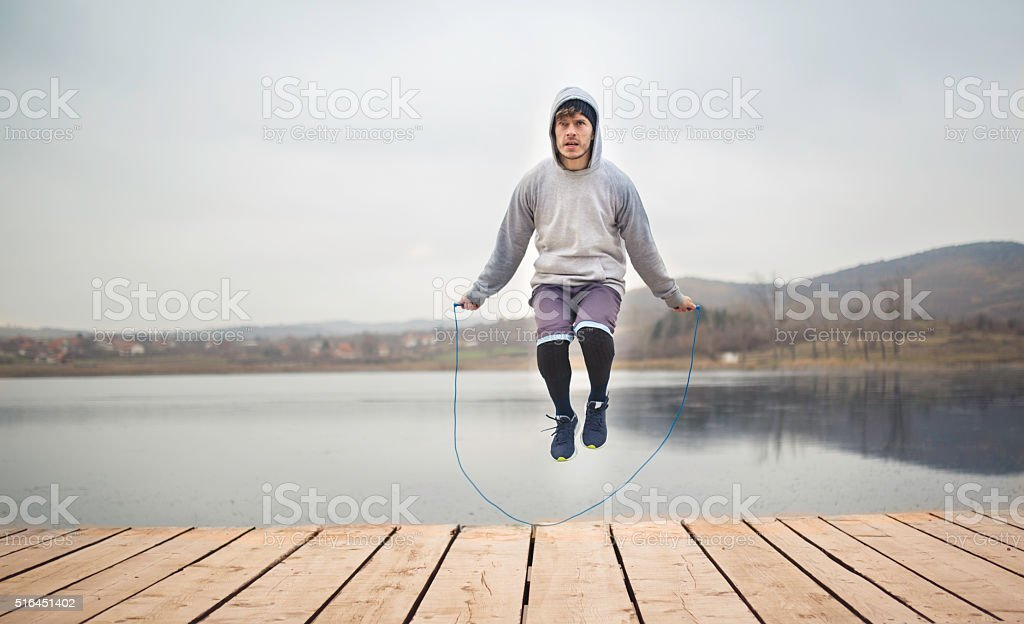 Fit man jumping rope. stock photo