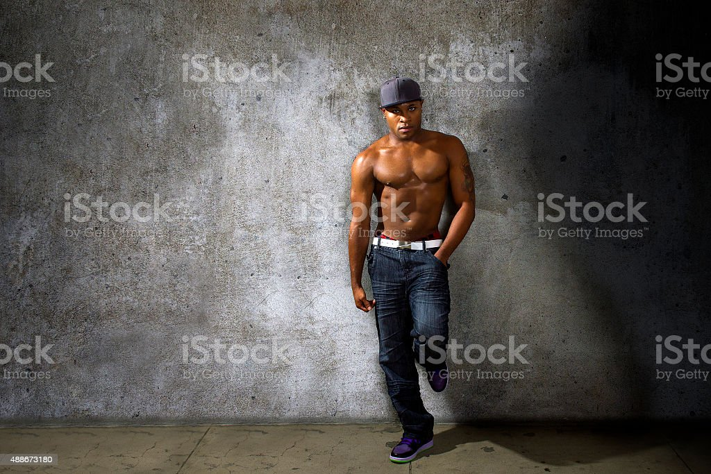 Fit Man Leaning On Wall stock photo