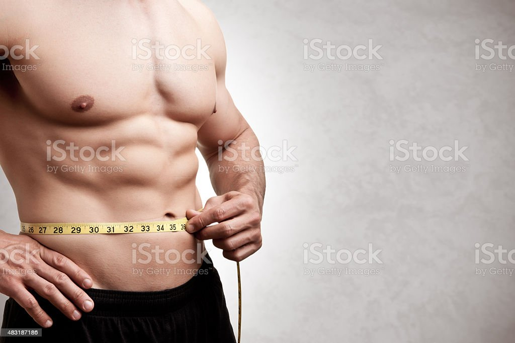 Fit Man Measuring His Waist stock photo