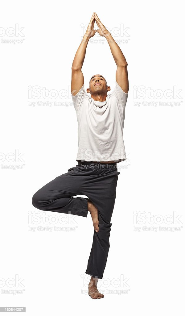 Fit Man Practicing Yoga - Isolated royalty-free stock photo