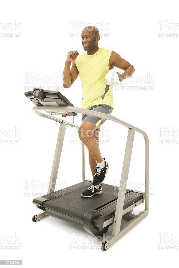 Fit Man Running on Treadmill royalty-free stock photo