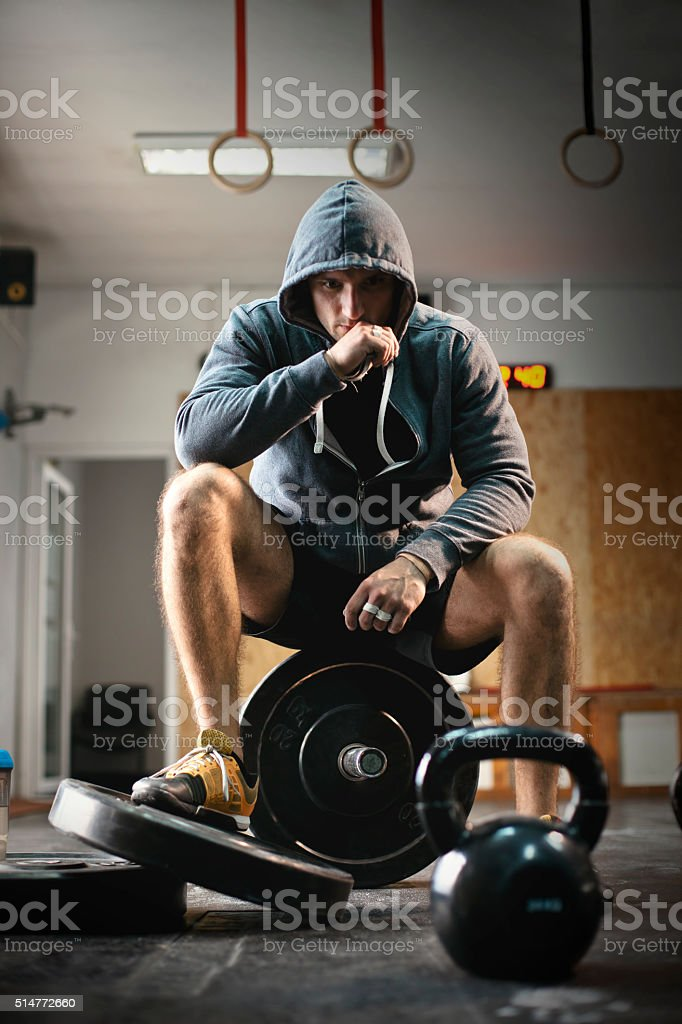 Fit man taking a break from working out stock photo