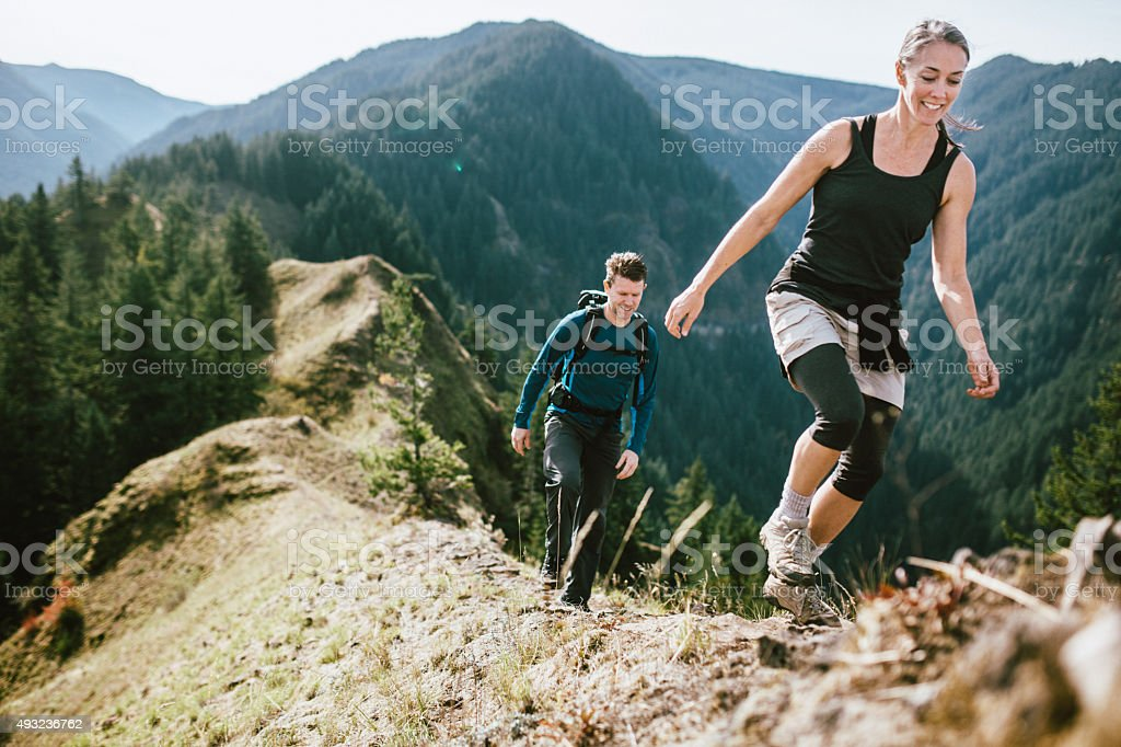 Fit Mature Adults on Mountain Hike stock photo