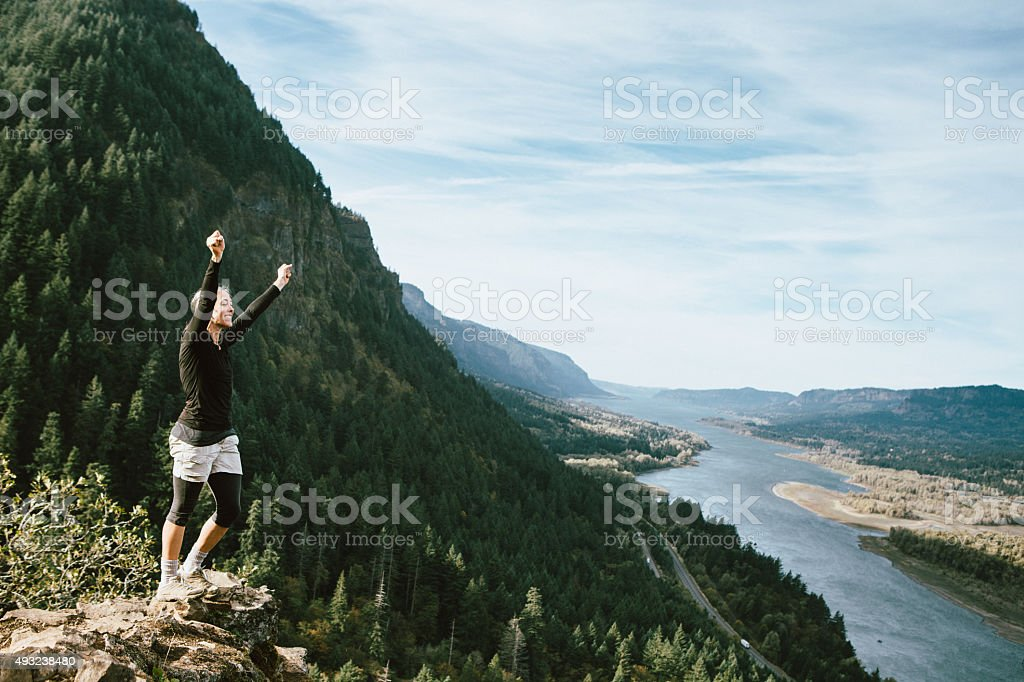 Fit Mature Woman at Mountain Viewpoint stock photo