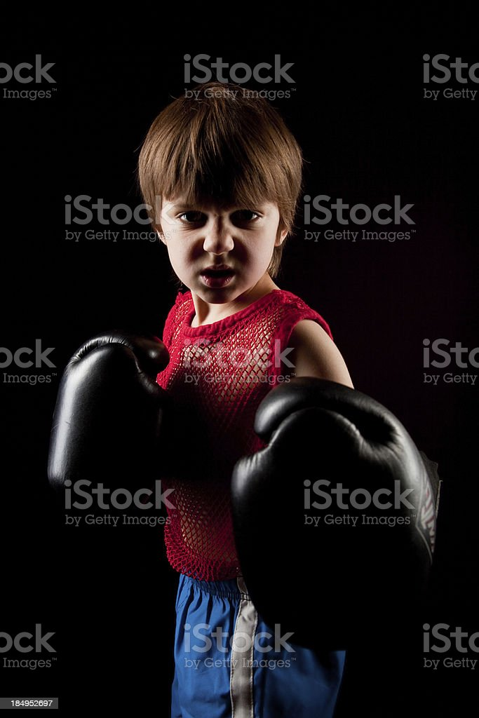 Fit Mean Tough young boxer Boy on dark black background stock photo