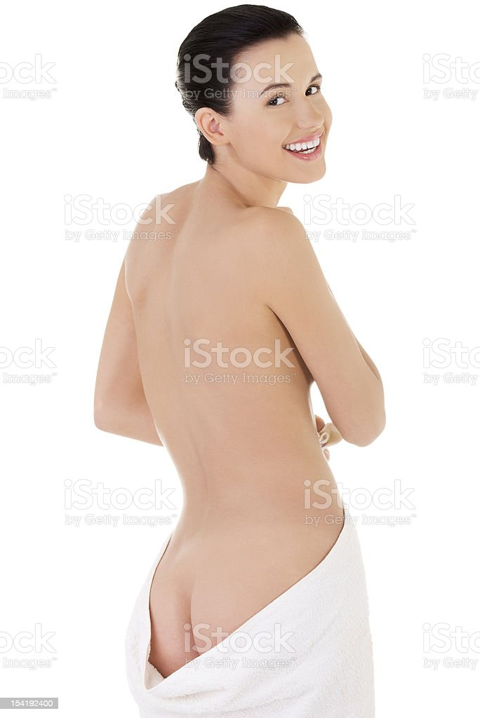 Fit nude woman with towel around her waist royalty-free stock photo