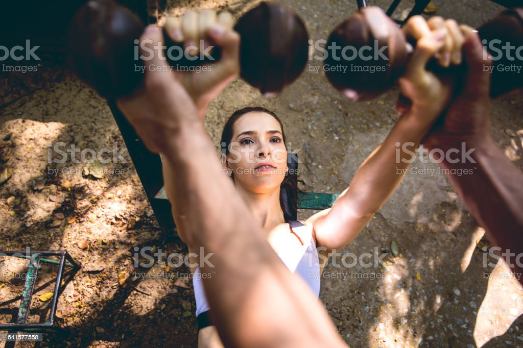 Fit people exercising and running in the city streets and public park stock photo