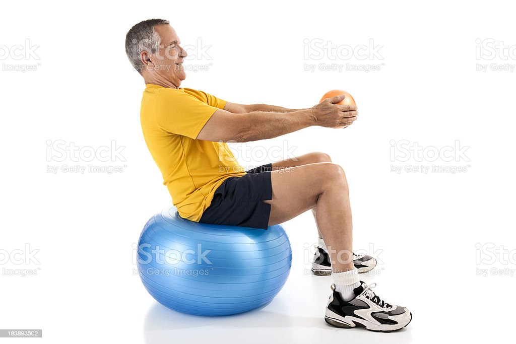 Fit senior man exercising with medicine and fitness ball royalty-free stock photo