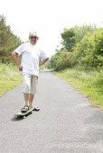Fit senior man with skateboard