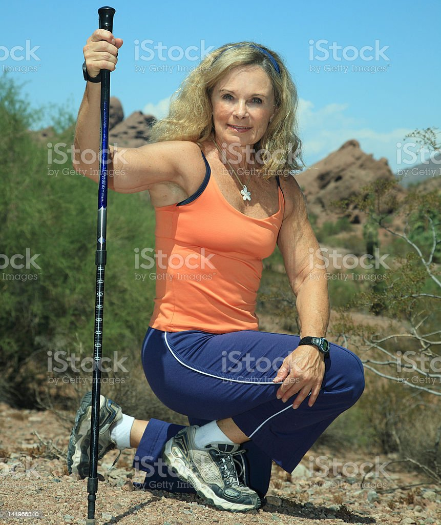 Fit senior woman hiking in Arizona stock photo