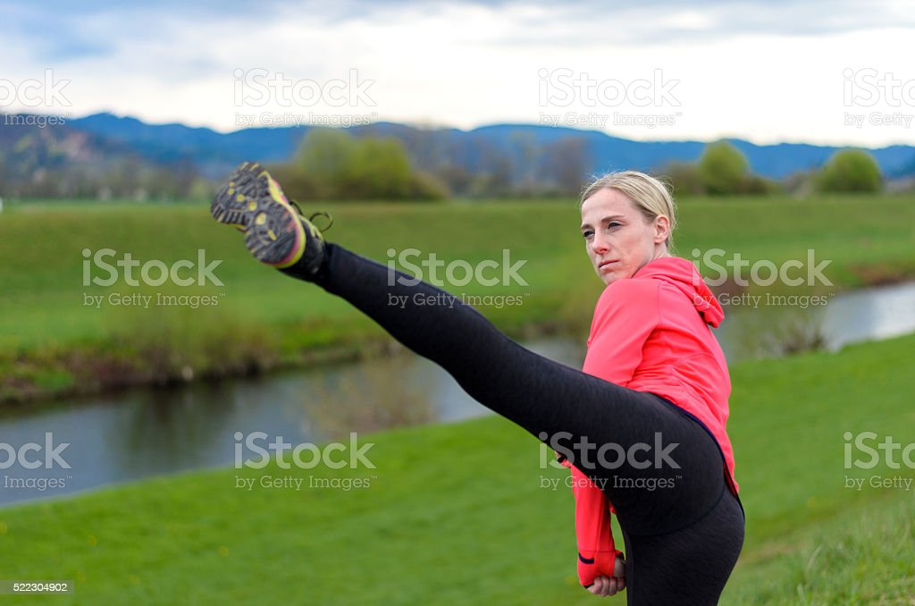 Fit supple young woman working out stock photo