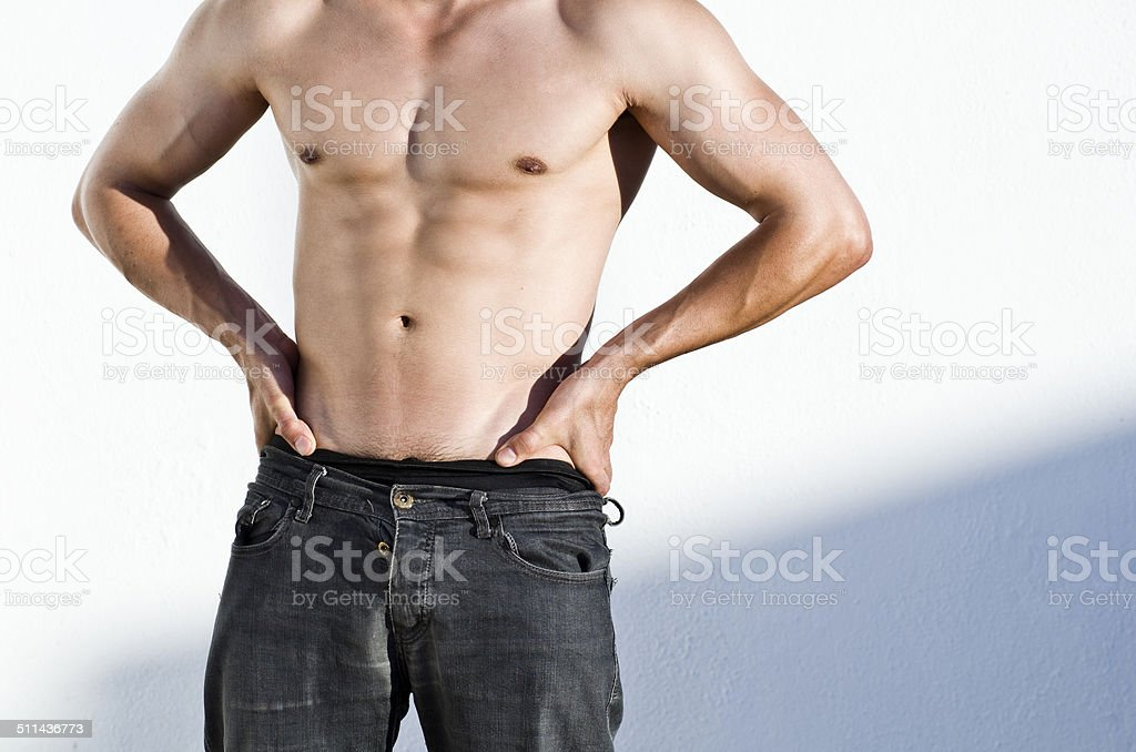 Fit torso on anonympus man stock photo