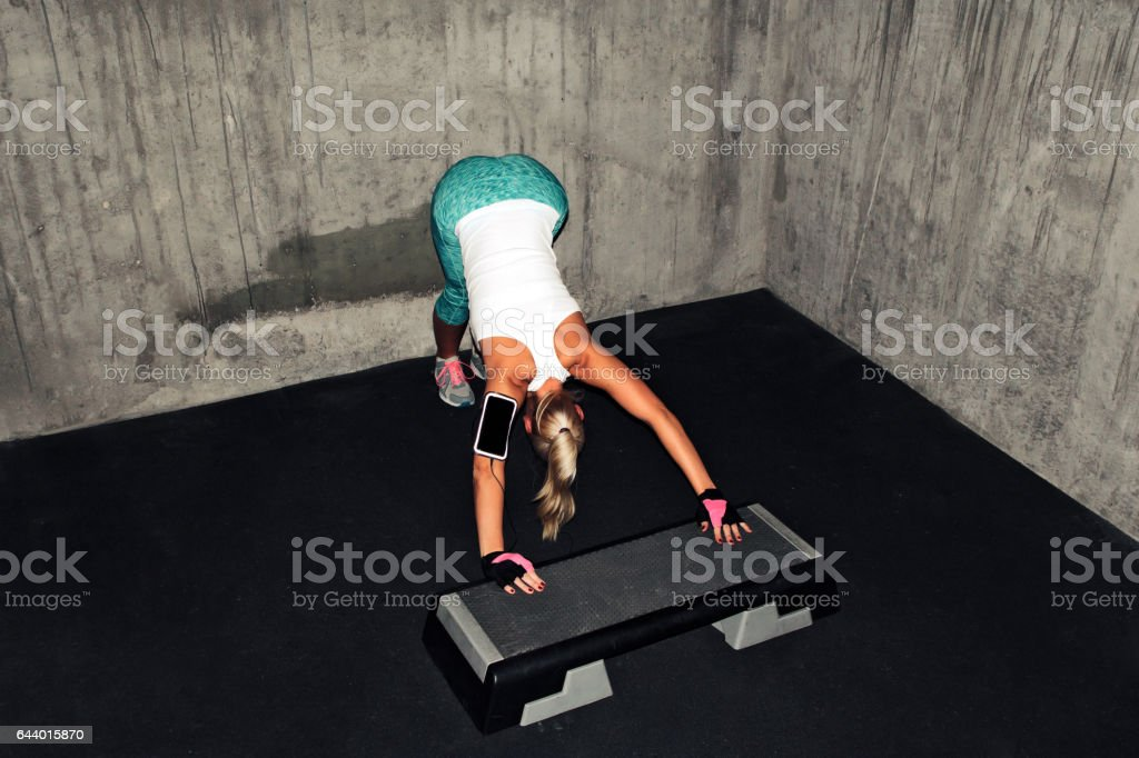 Fit Woman doing exercises on a Step Board stock photo