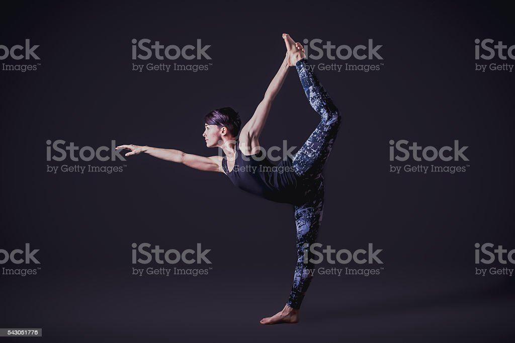 Fit Woman Doing Yoga stock photo