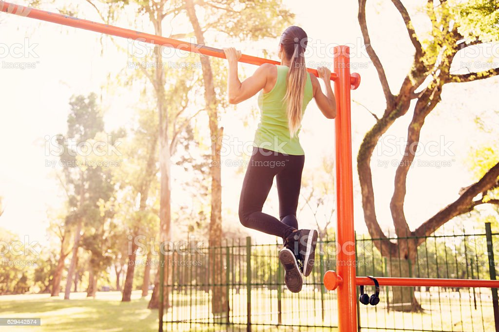 Fit woman exercising outdoors stock photo