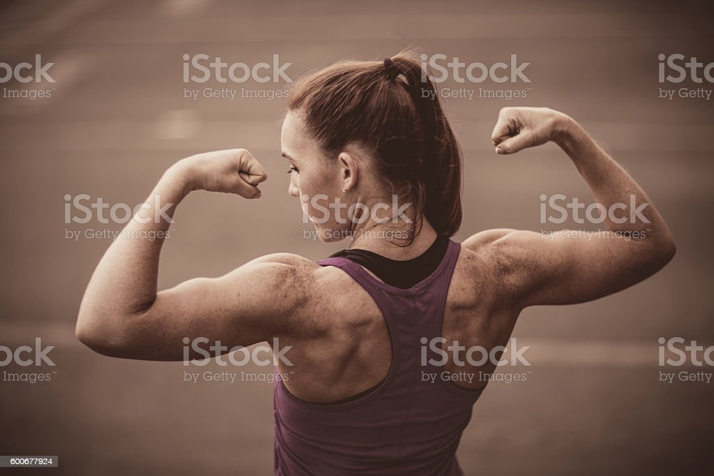 Fit Woman Flexing stock photo