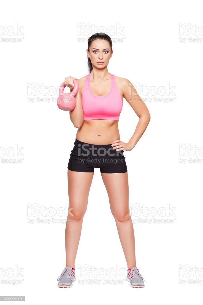 Fit woman holding kettlebell royalty-free stock photo