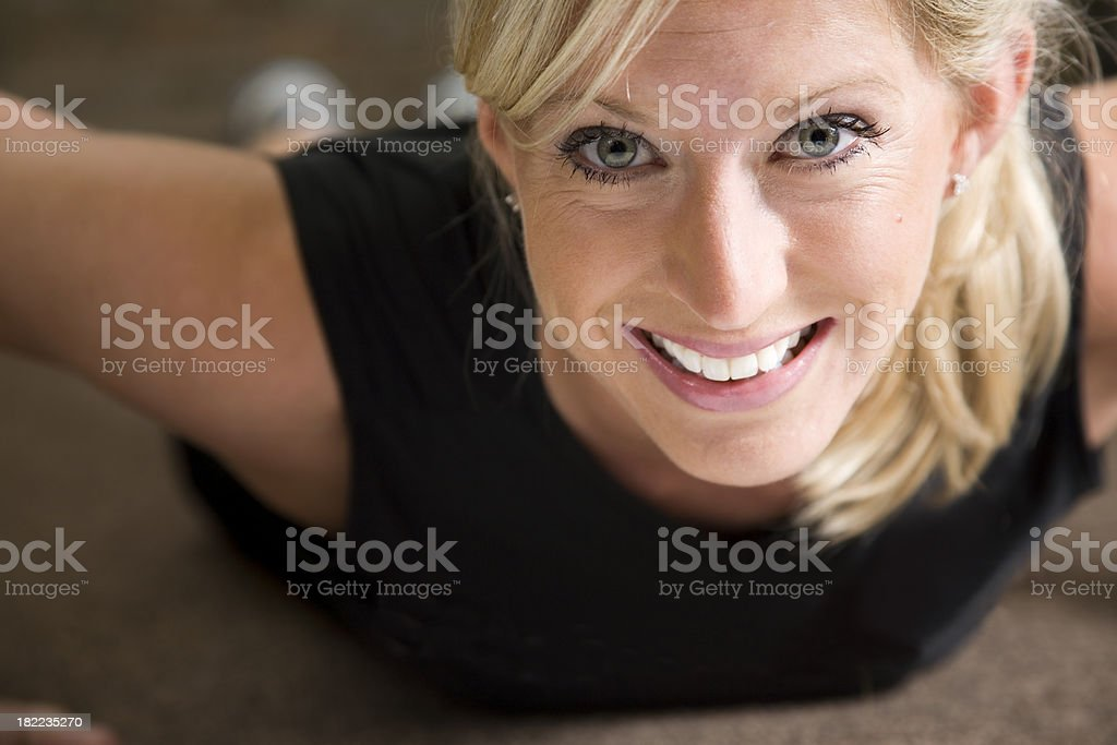 Fit Woman Looking Up While Doing Pushups royalty-free stock photo
