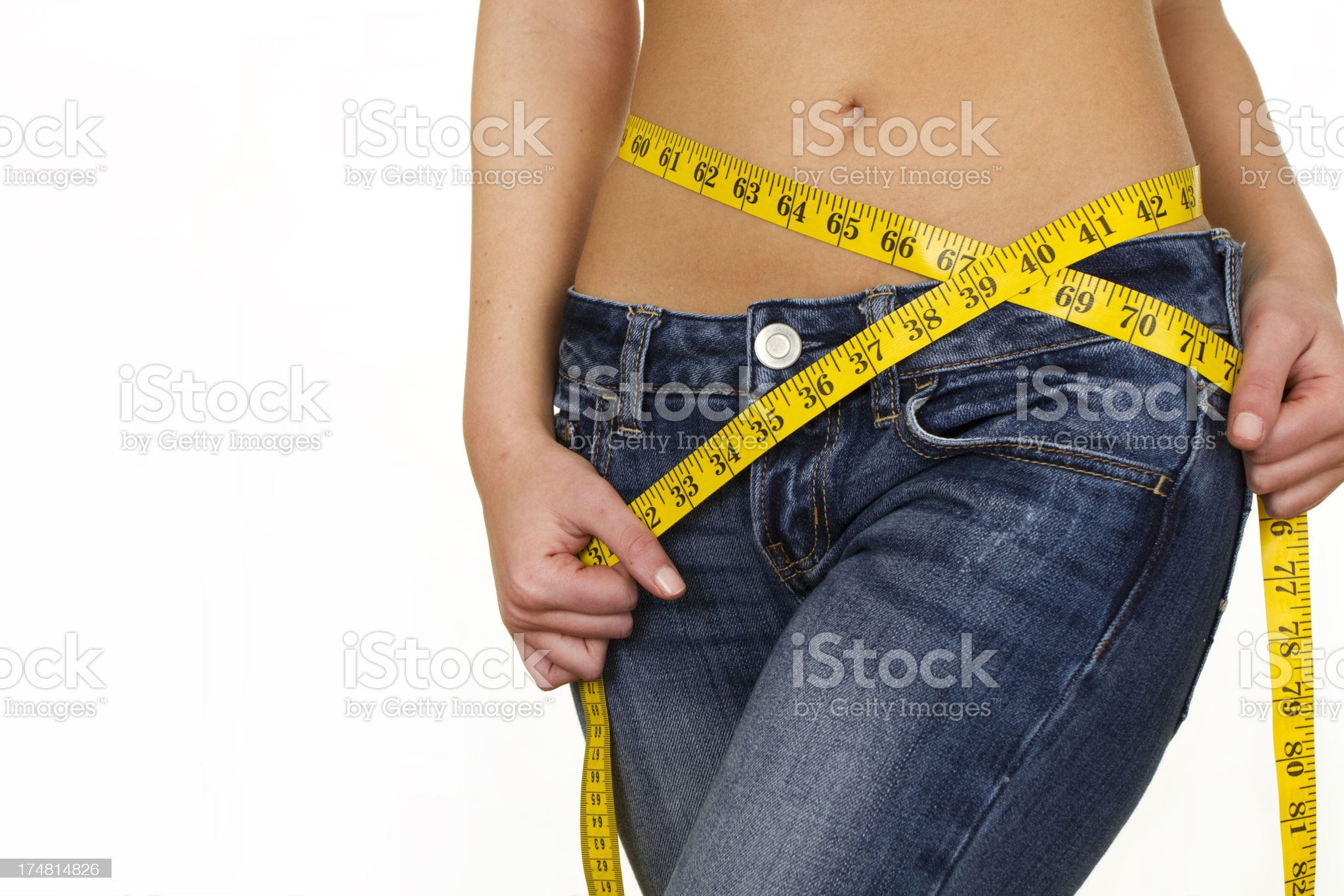 fit woman measuring waist royalty-free stock photo