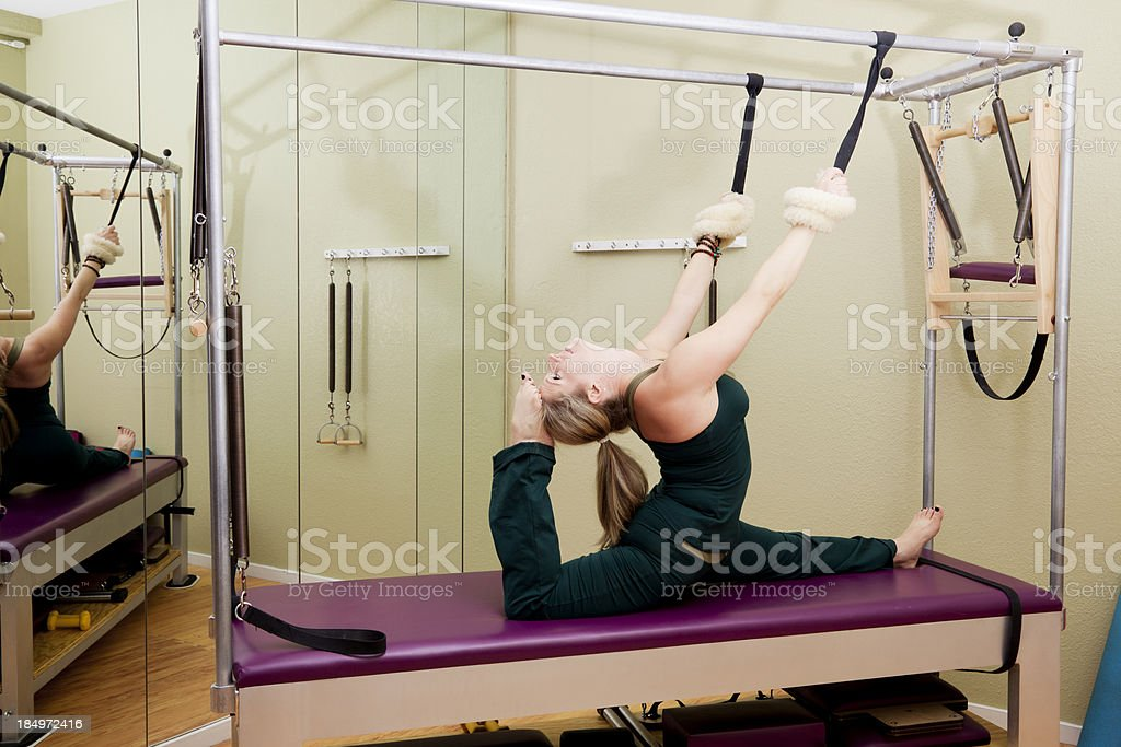 Fit woman on pilates reformer machine stock photo