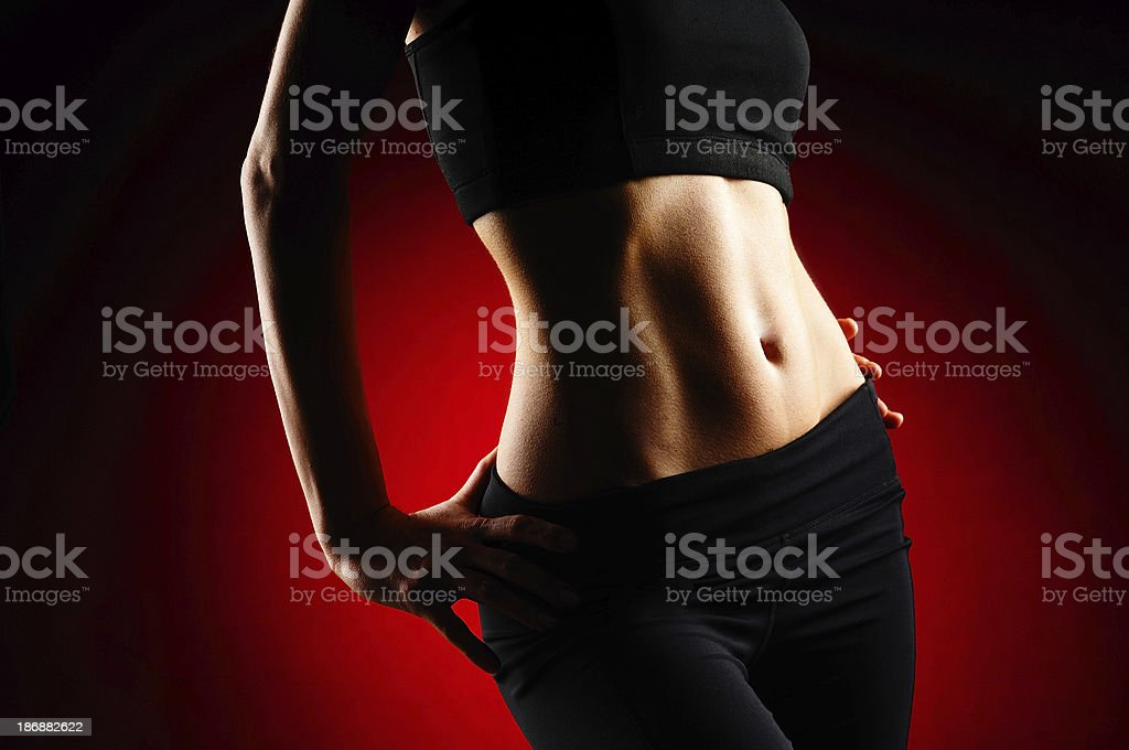 Fit Woman on Red Background royalty-free stock photo