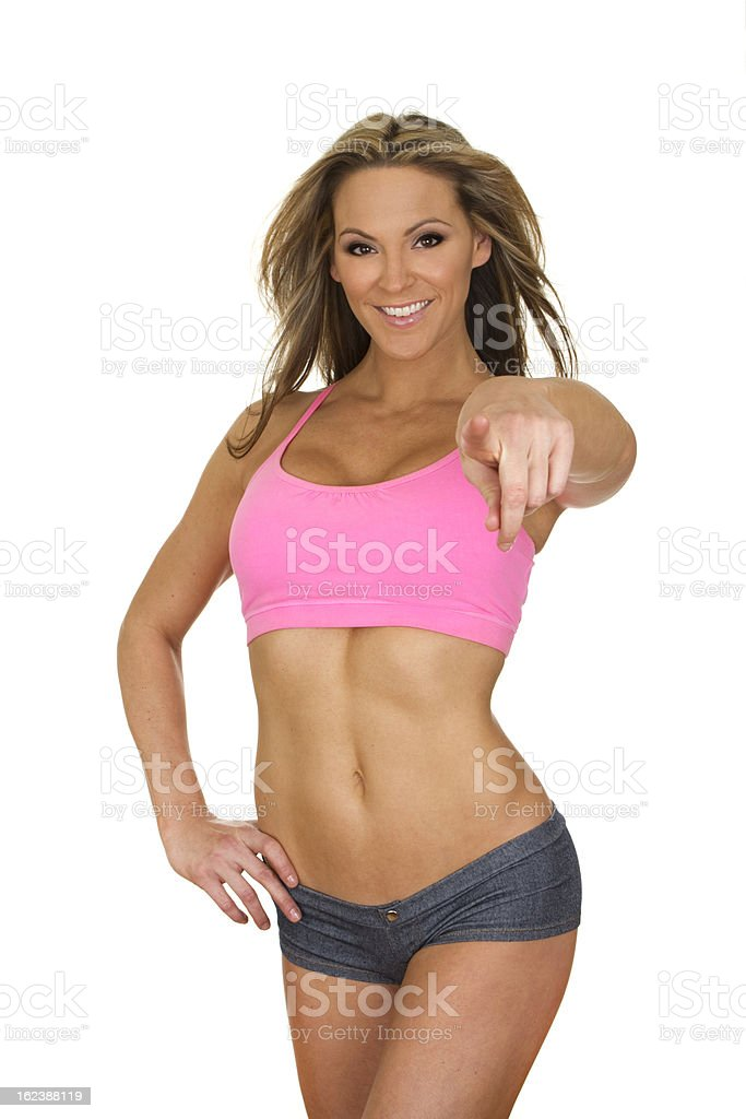 fit woman pointing at camera royalty-free stock photo