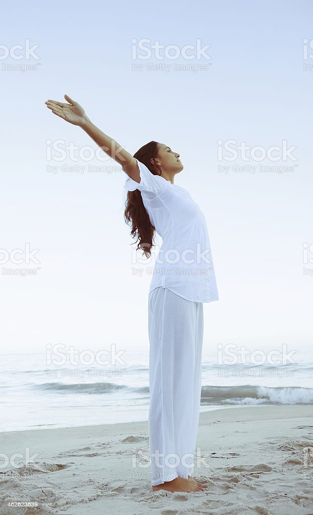 Fit woman stretching arms up royalty-free stock photo