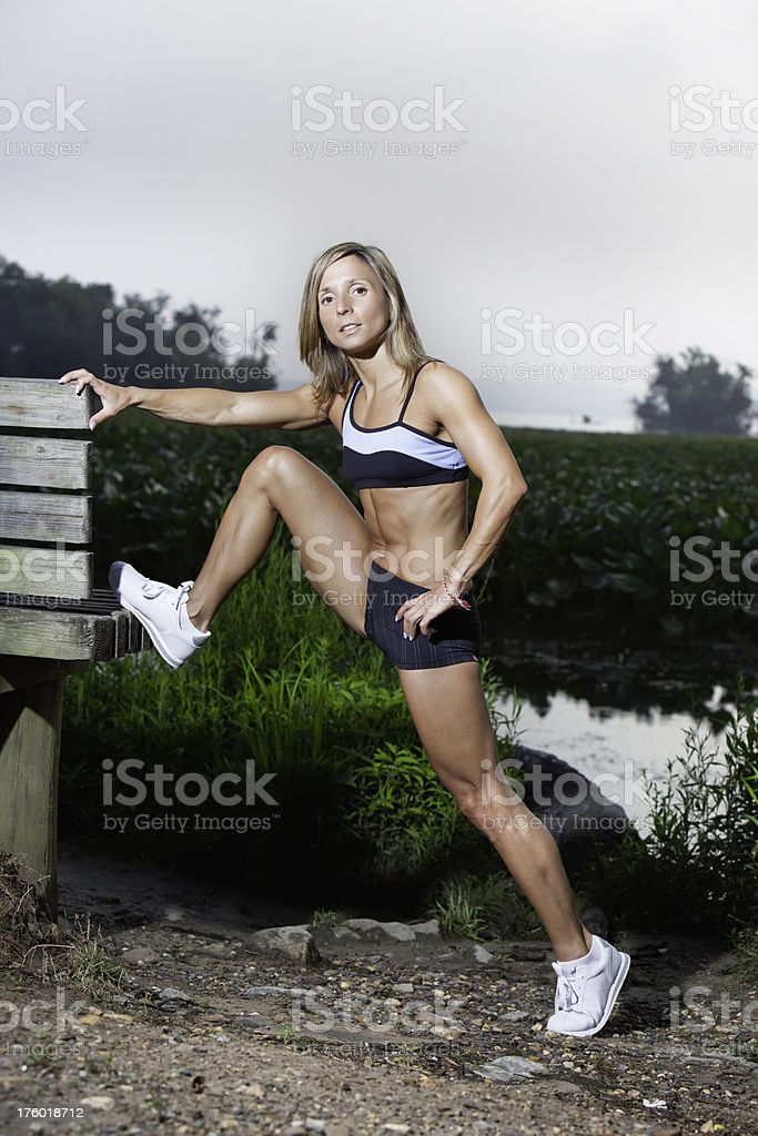 Fit woman stretching before a run royalty-free stock photo