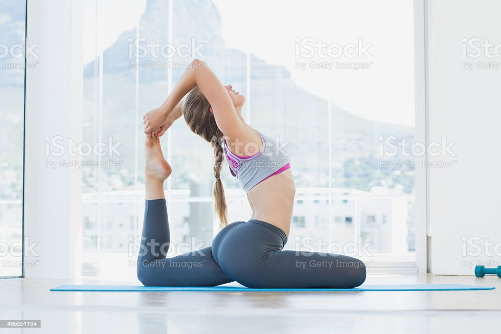 Fit woman stretching body in exercise room stock photo
