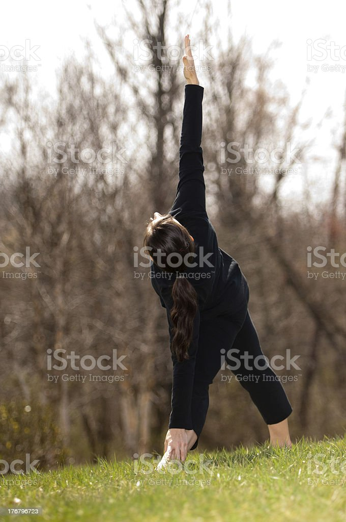 Fit Woman Stretching in Nature stock photo
