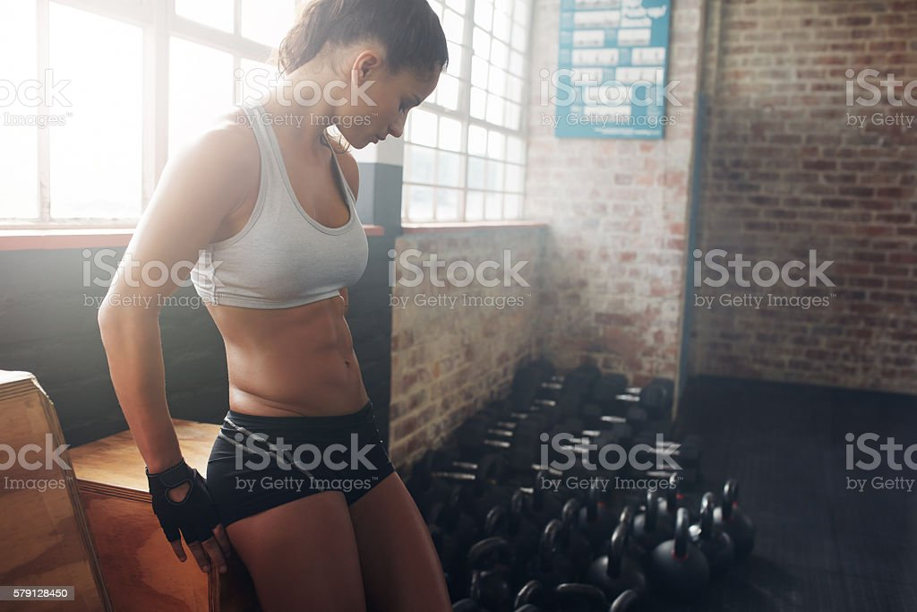 Fit woman taking a break from her workout stock photo