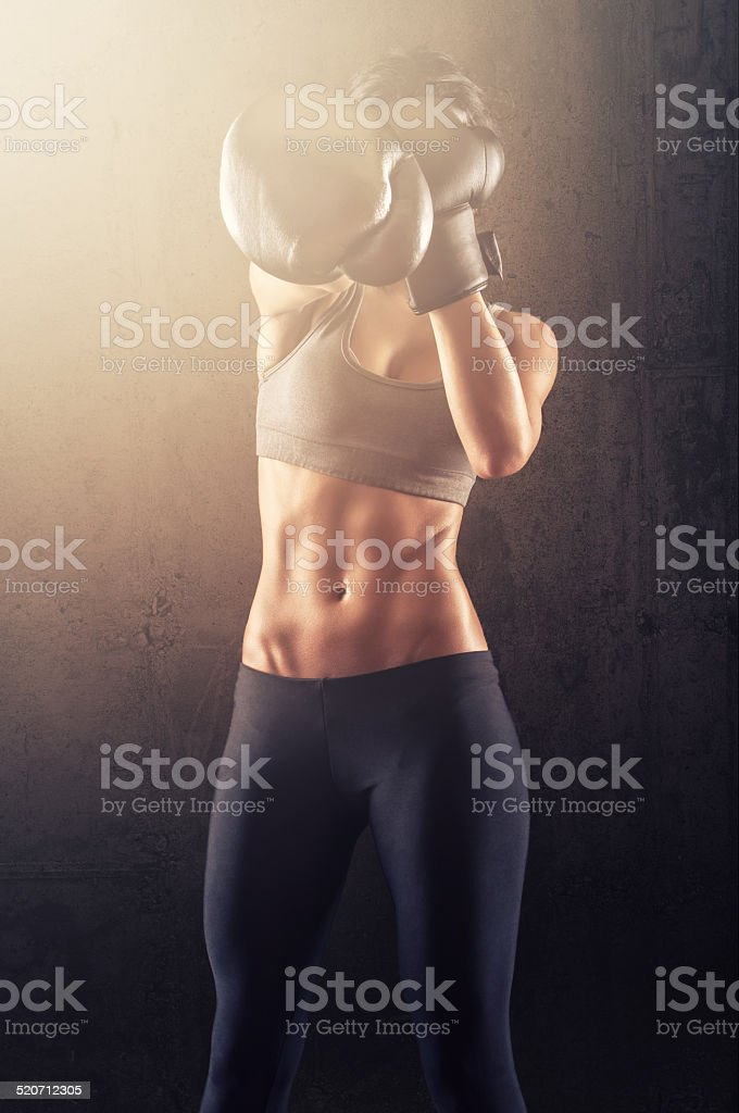 Fit woman with boxing gloves stock photo