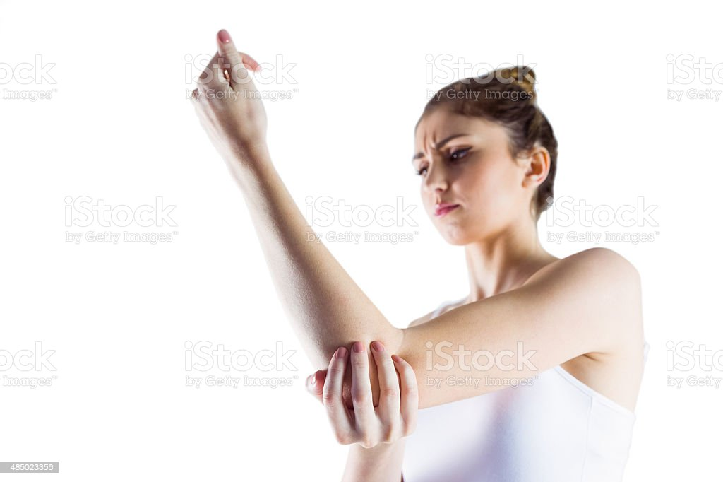 Fit woman with elbow injury stock photo