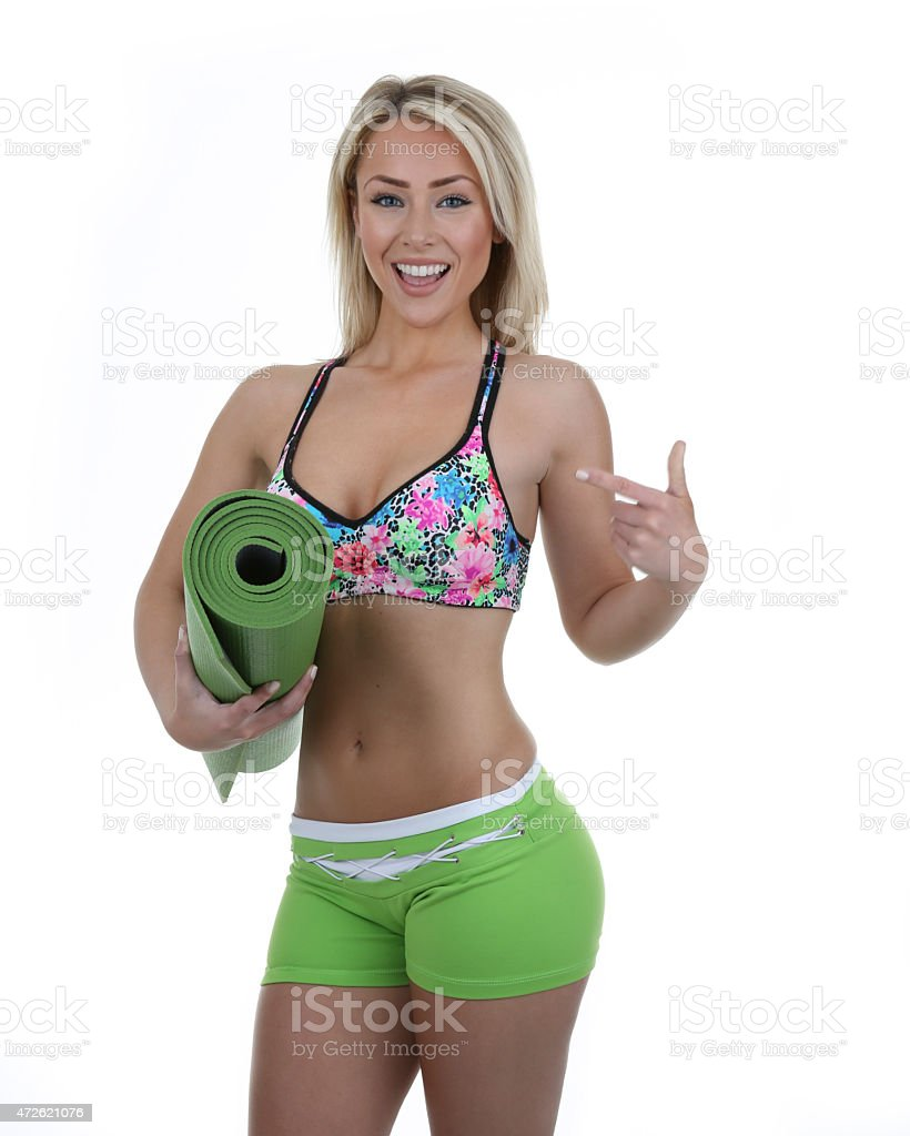 fit woman with yoga mat stock photo