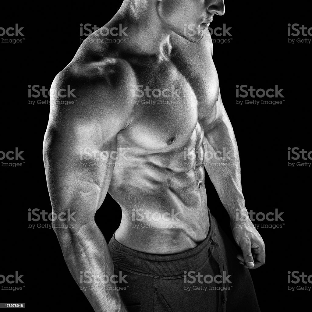 Fit young bodybuilder fitness male model posing stock photo