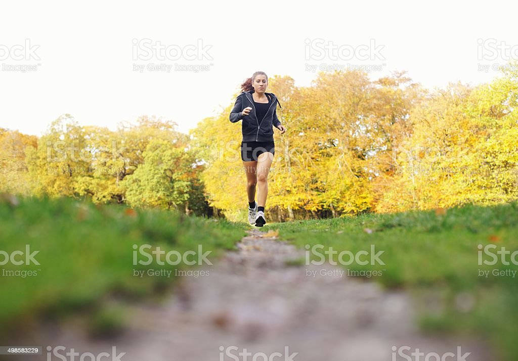 Fit young woman jogging in a park stock photo